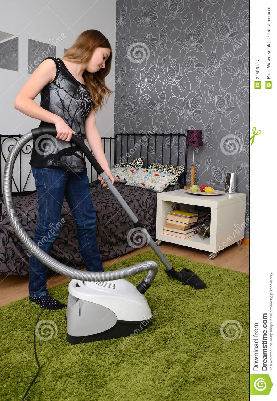 Teenager With Vacuum Cleaner Royalty Free Stock