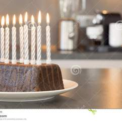 Kitchen Candles Lowes Outdoor Island Ten Burning On A Birthday Cake In Modern Stock Chocolate With Lighted Anniversary Or Standing Counter Front Of Kitchenette Stainless Steel