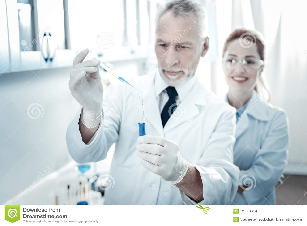 Test Tube Being Held By A Smart Professional Scientist