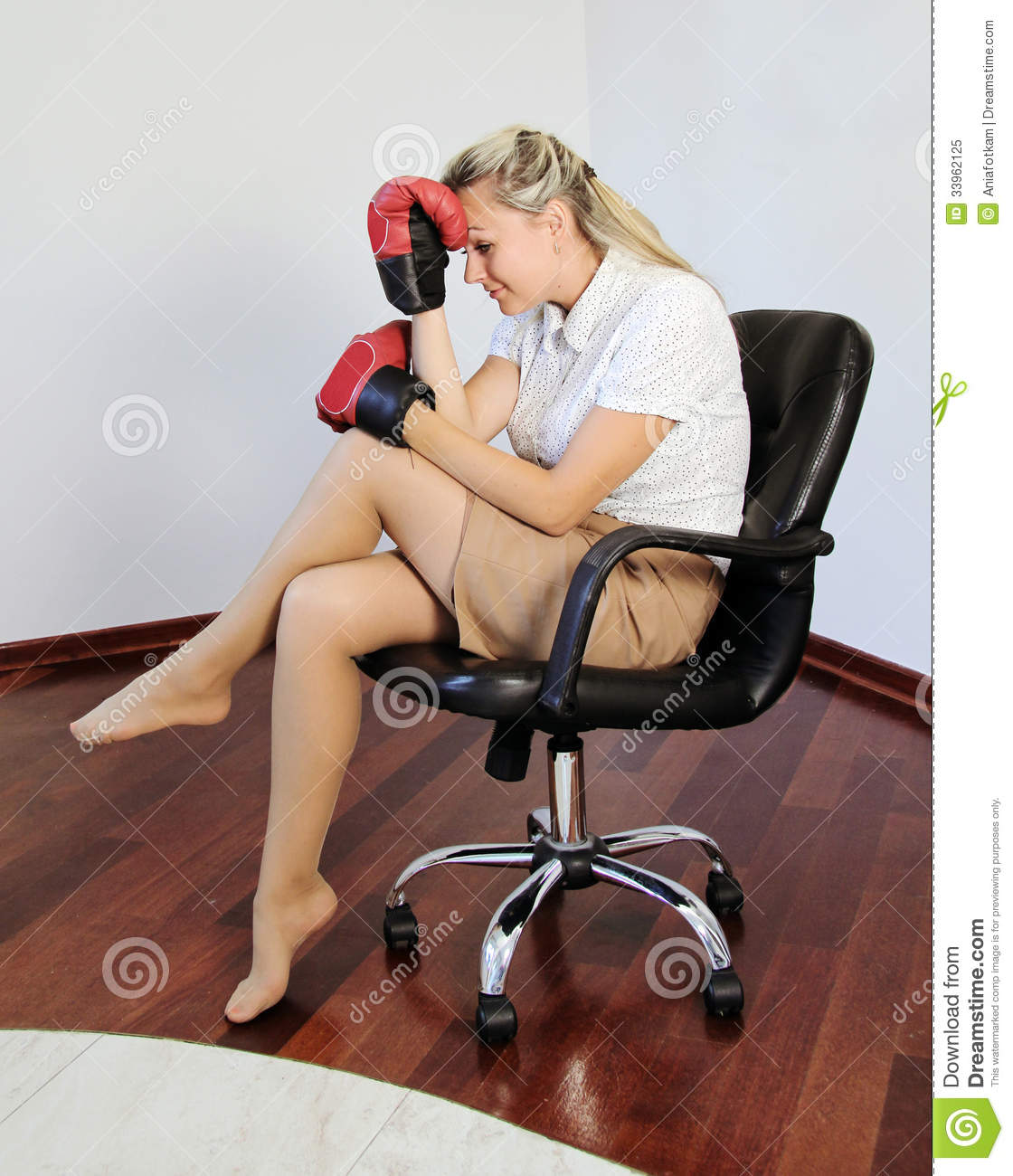 Thinking Busienss Woman Holding Head In Boxing Glove Stock