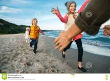 Kids Playing Beach Stock