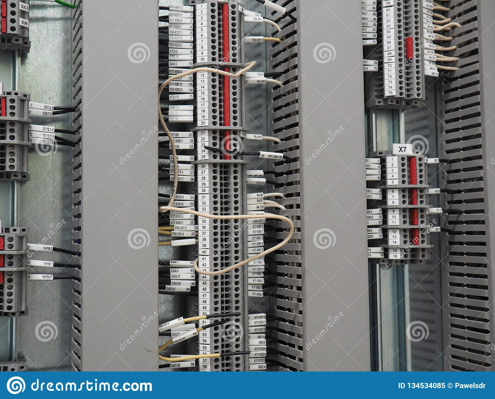 hight resolution of  terminals and three vertical rows of cable trays cables conected in numbered terminals all mounted on the steel plate one white wire in the centre