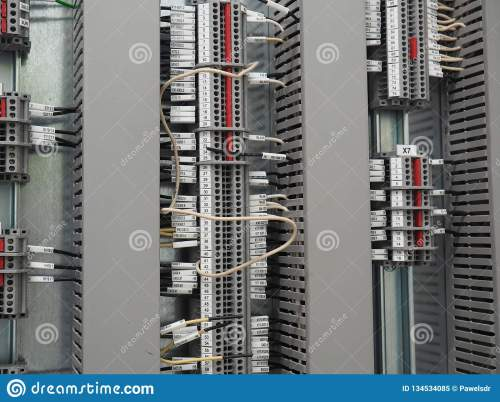 small resolution of  terminals and three vertical rows of cable trays cables conected in numbered terminals all mounted on the steel plate one white wire in the centre