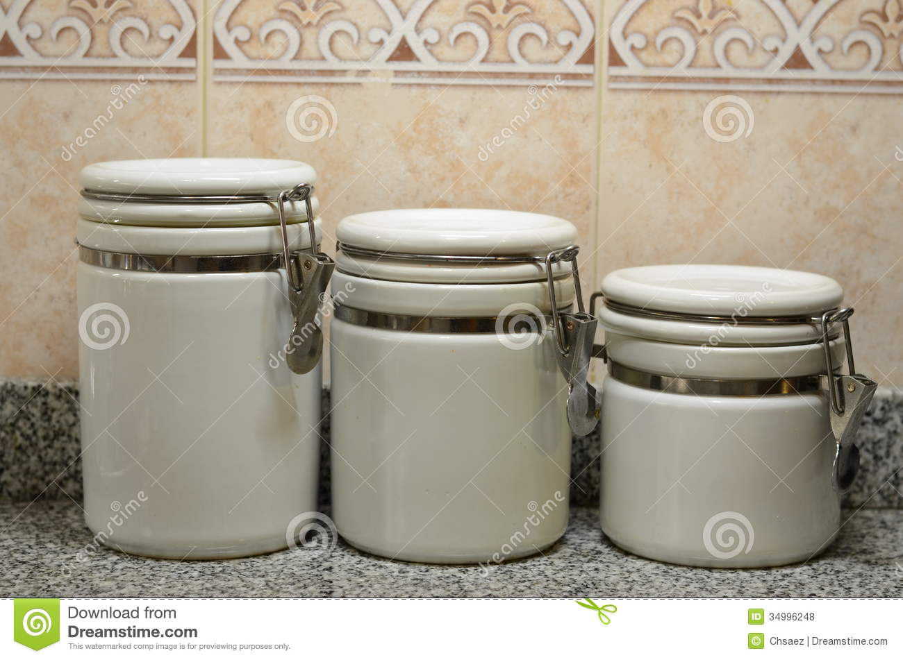 kitchen canisters ceramic towel rack three white jars on counter stock photo ...