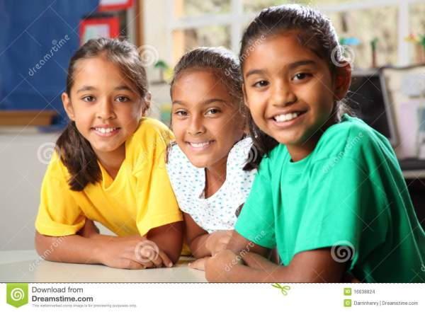 Three Young Primary School Girls Sitting In Class Stock