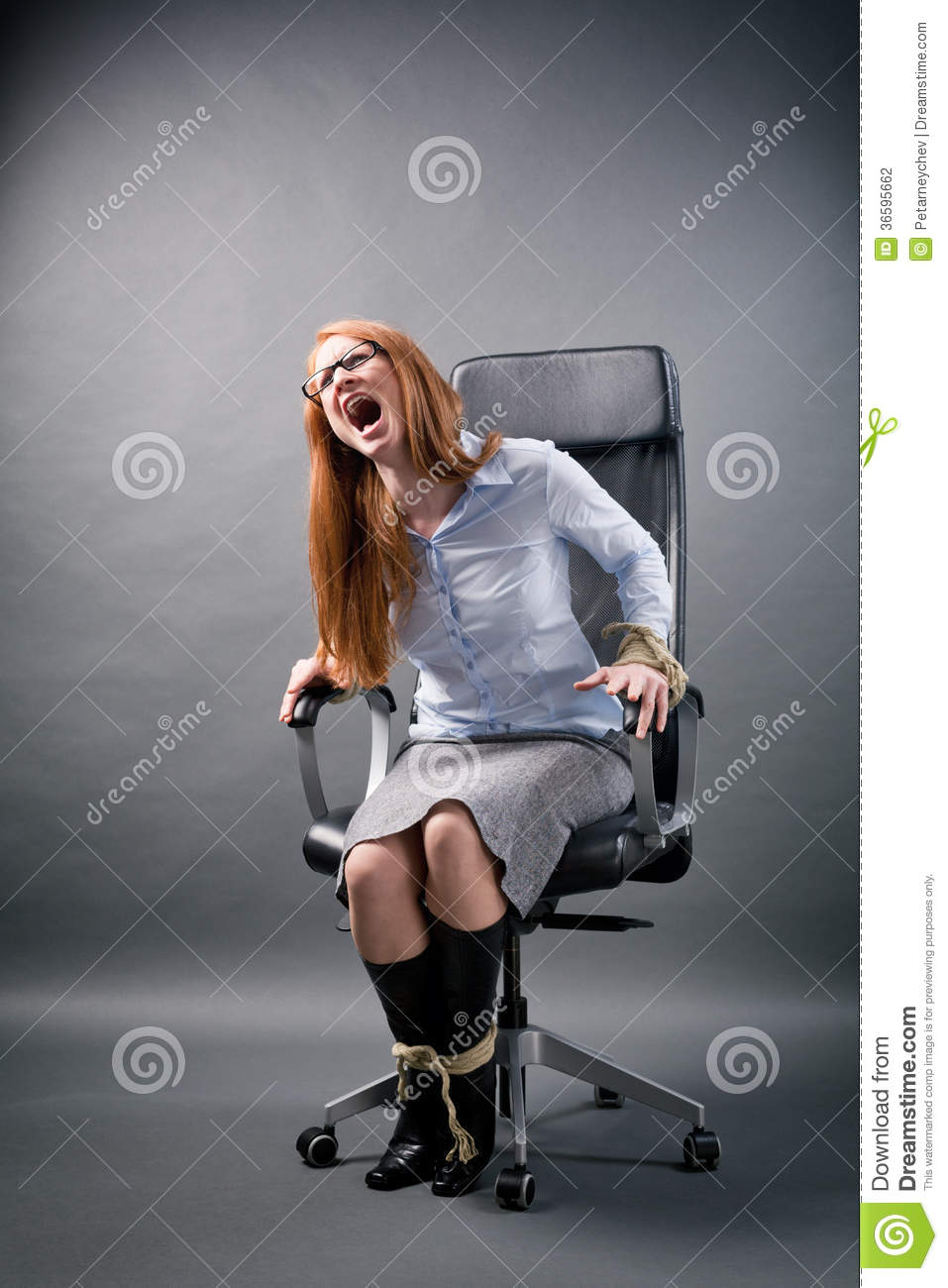 Tied Up Businesswoman Shouting For Help Stock Photo