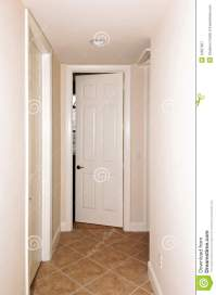 Tiled hallway with doors stock image. Image of apartment ...