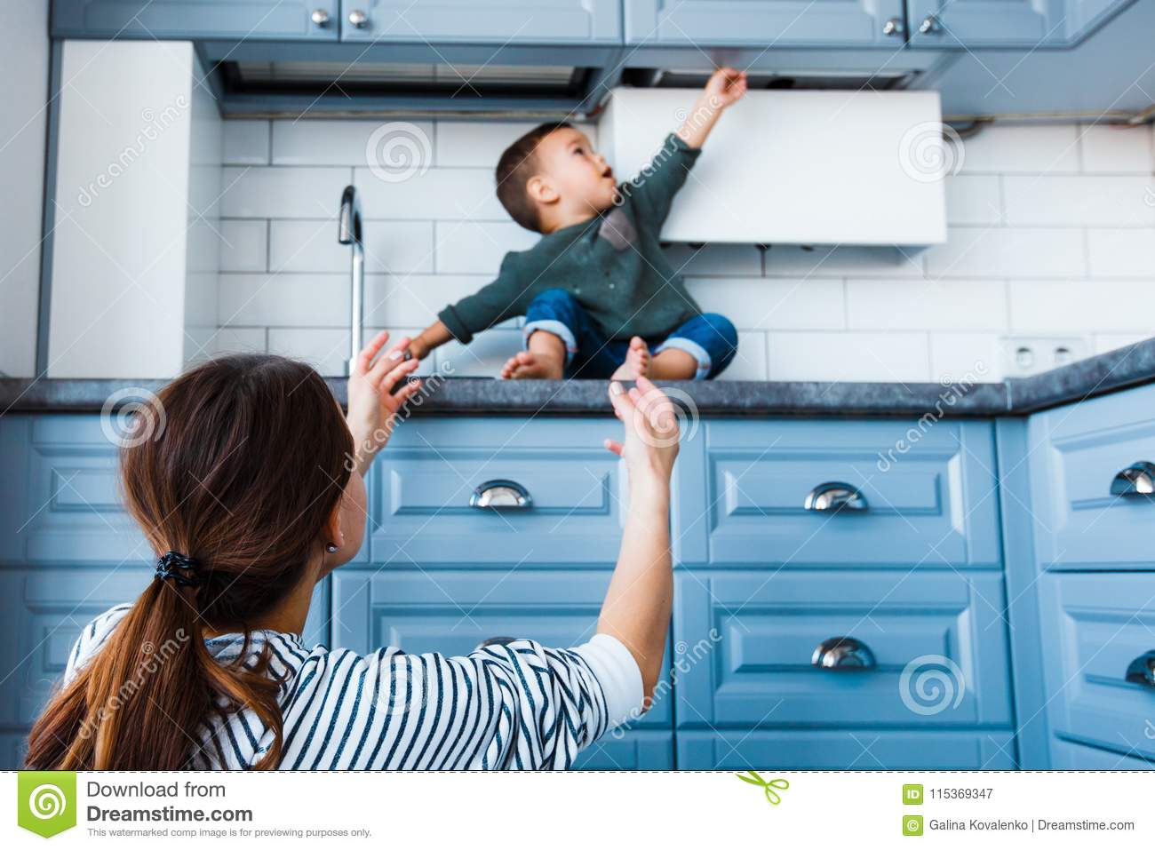 Toddler Child In Kitchen Children Safety At Home Concept Stock Image