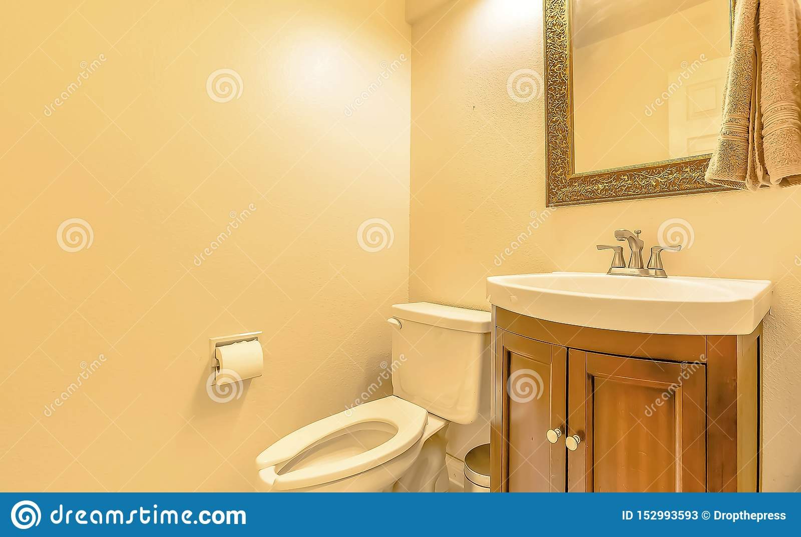 Toilet And Sink Inside The Bathroom Of A House With Cream Colored Wall Stock Image Image Of Architectural Clean 152993593