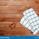 Top View On A Dark Wooden Table With A Linen Kitchen Towel Or Textile Napkin A Tablecloth On A Countertop Made Of Old Wood Stock Photo Image Of Decor Classic 181767968