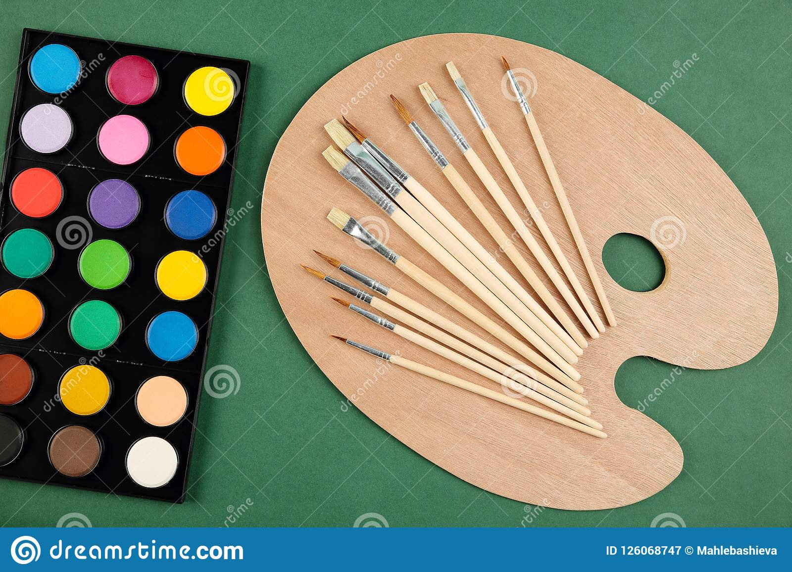 Top View Of A Set Of Watercolors Wooden Palette And Different Types Of Paint Brushes On A Dark Green Background Art Craft Scho Stock Image Image Of Artwork Paintbrush 126068747