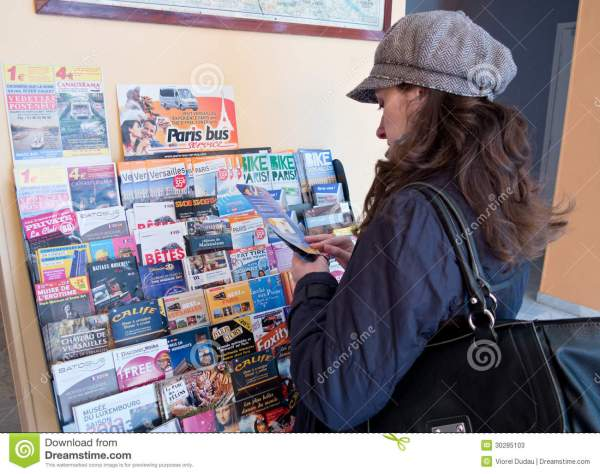Tourist Reading Travel Brochures Editorial Stock