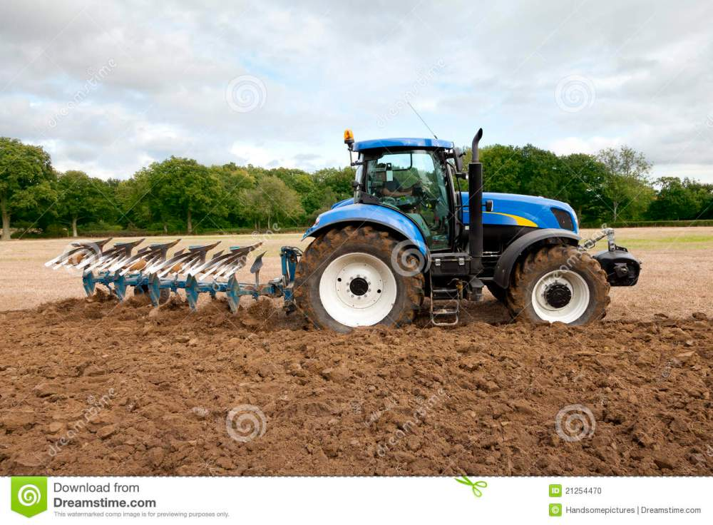 medium resolution of tractor ploughing field