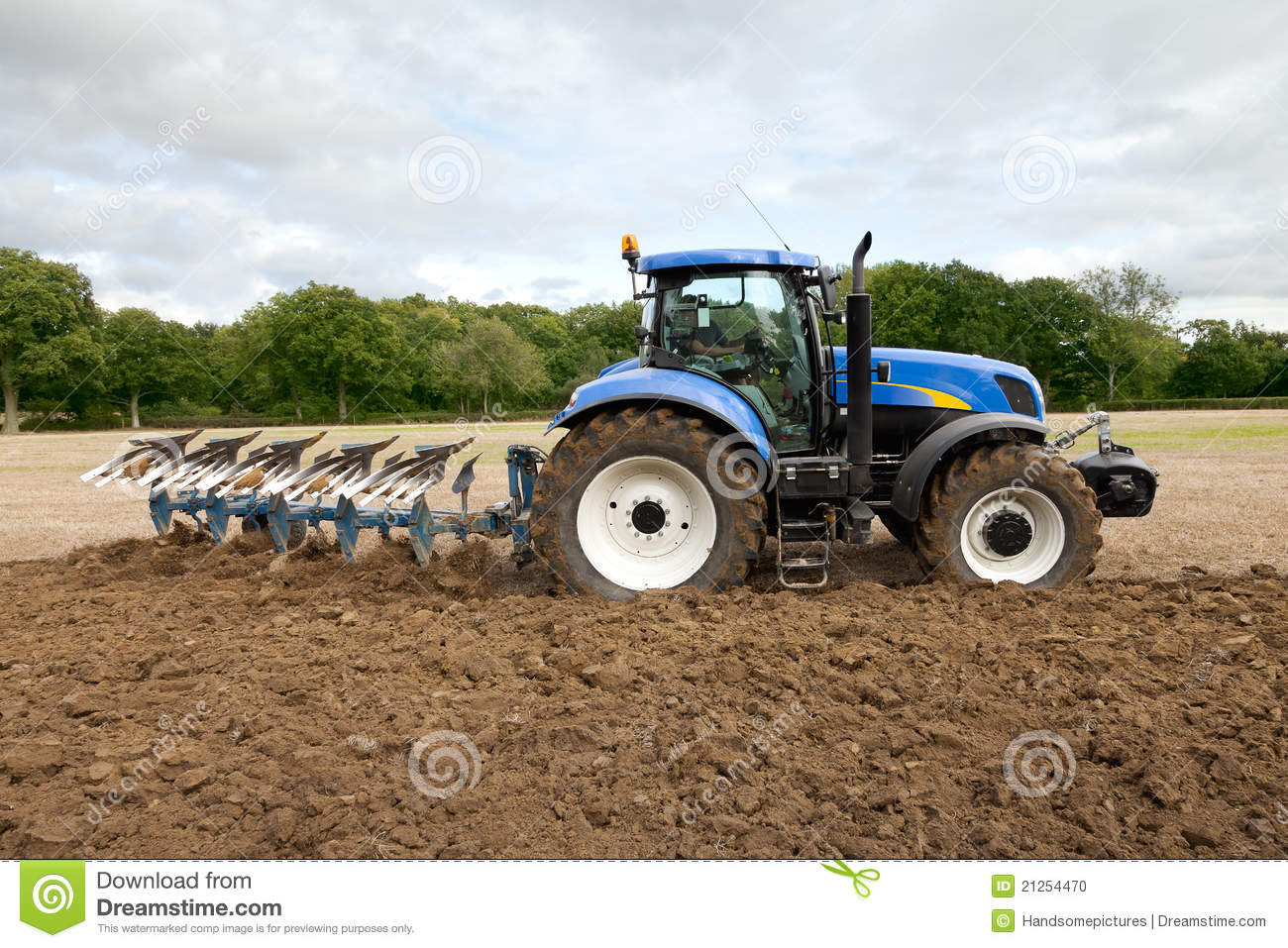 hight resolution of tractor ploughing field