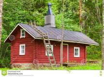 Traditional Scandinavian Red Wooden House In Forest Stock
