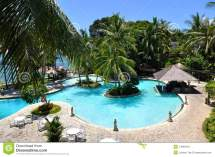 Tropical Beach Resort With Swimming Pool Stock