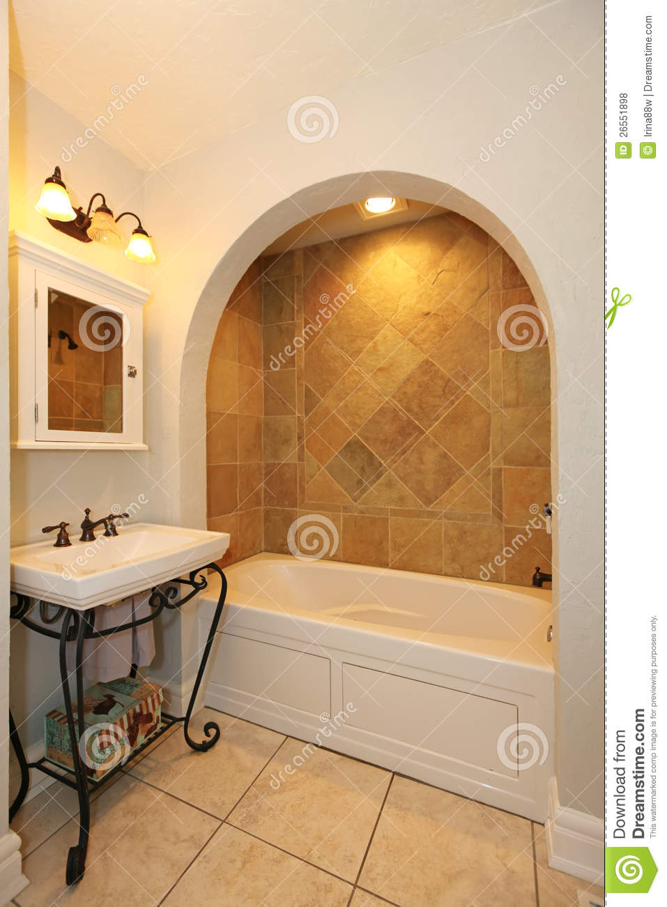 Tub With Arch And Stone Tiles Sink Bathroom Stock Photo