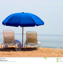Beach Chairs And Umbrella Chair Rentals Okc Two Stock Photo Image Of Sand Shells