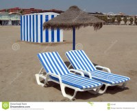 Two Beach Chairs Under Umbrella And A Cabin Royalty Free ...