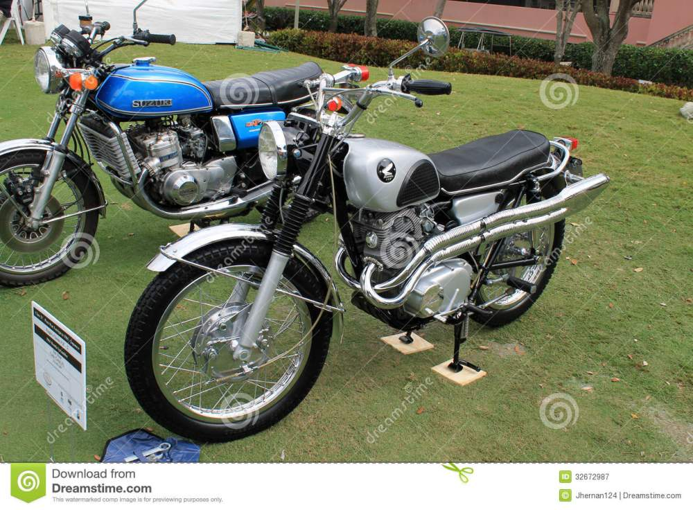 medium resolution of two classic japanese motorcycles lined up