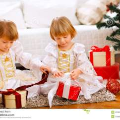 Twin Bed Sofa Couch L Shaped Colour Combination Two Happy Girls Opening Gifts Near Christmas Tree Royalty ...
