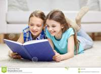 Two Happy Girls Reading Book At Home Stock Photo - Image ...