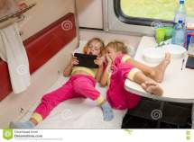 Two Little Girls Lie Train With Feet Lower