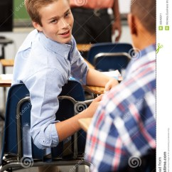 Teen Desk Chair Childrens Plush Chairs Two Male Pupils Talking In Class Stock Image - Image: 30848911