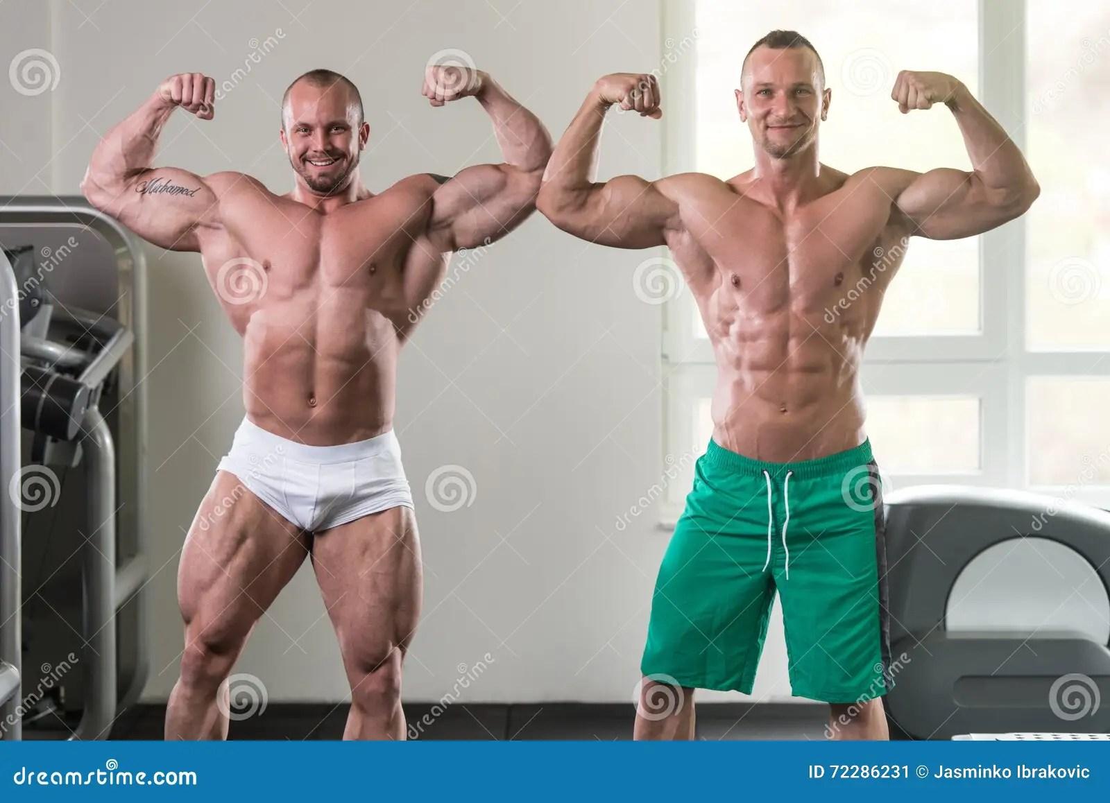 two muscular men flexing