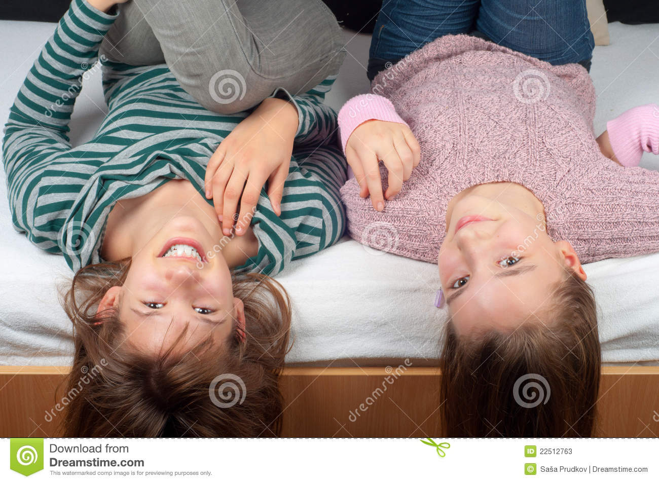 Two Pretty Teenage Girls Lying In Bed Stock Photos