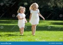 Little Girl Running in White Dress