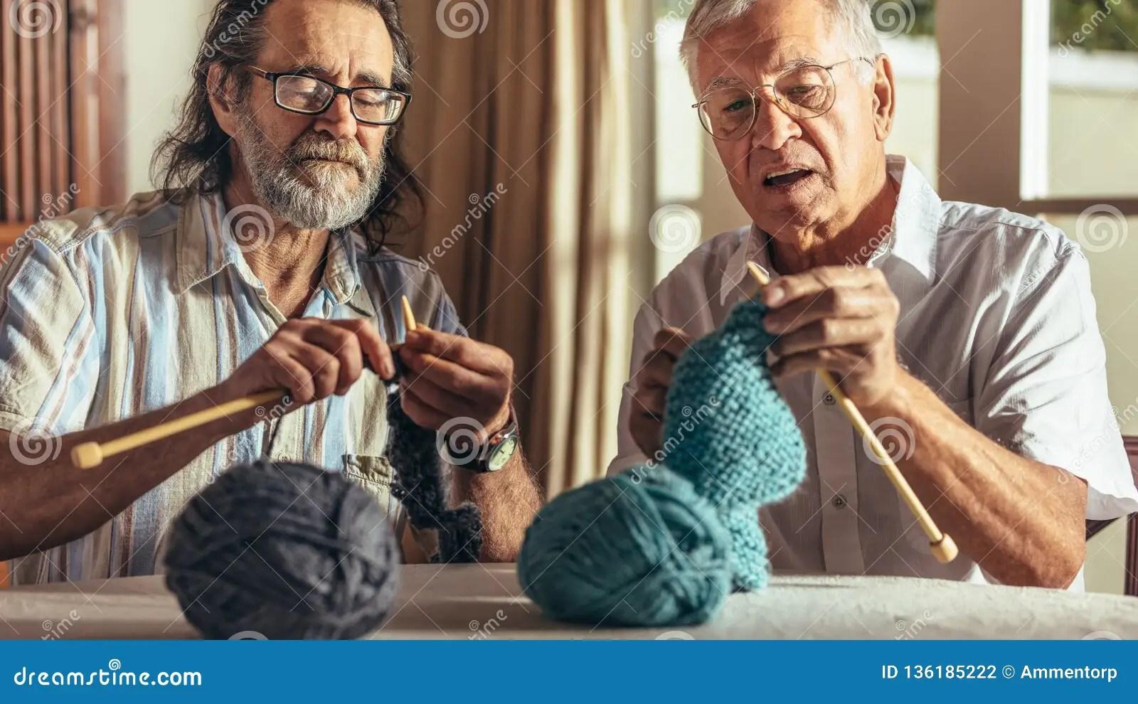 two senior friends knitting