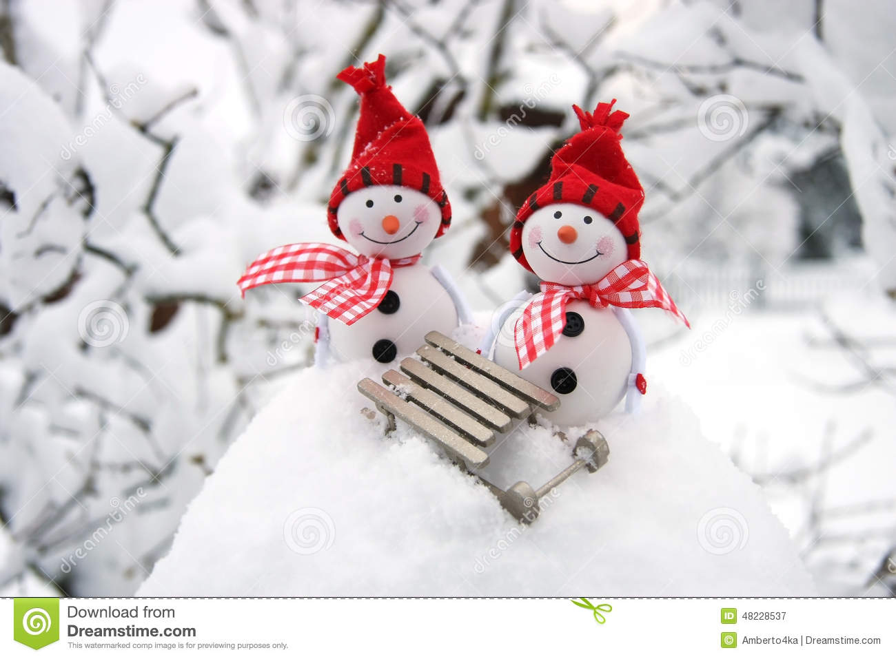 Two Smiling Snowmen Friends In The Snow Stock Photo