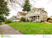 Two Story American House With White Column Porch Stock