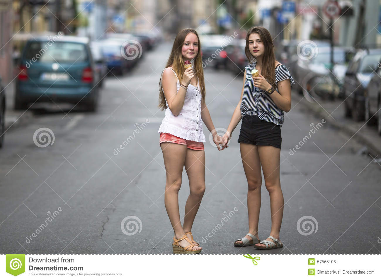 Ice Fall Wallpaper Two Teen Girls With Ice Cream Stand On The Street Holding