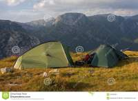 Two tents in the mountains stock photo. Image of fjell ...