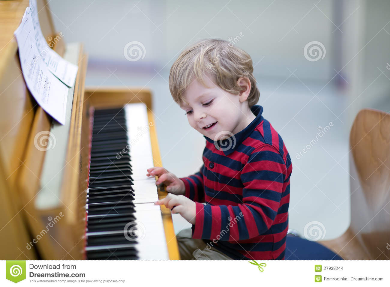 Two Years Old Toddler Boy Playing Piano Stock Photo