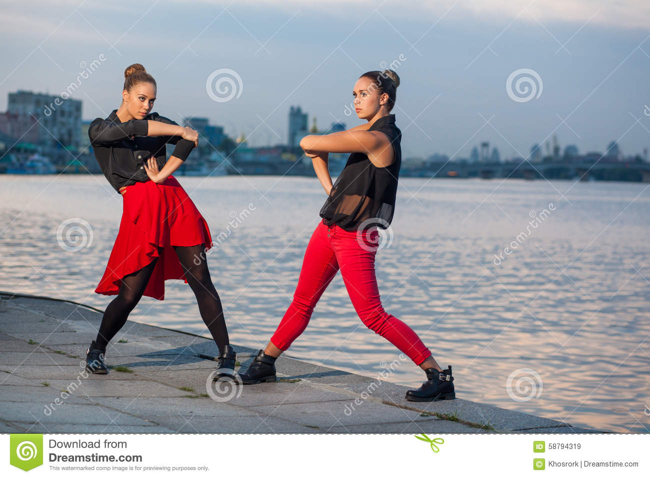 Two Young Beautiful Twin Sisters Are Dancing Waacking Dance In The City Background Near River. Stock Image - Image of black, girl: 58794319