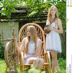 Retro White Chair Burnt Orange Velvet Armchair Two Young Women In Country Yard With Spinning Wheel And Rock Royalty Free Stock Image ...