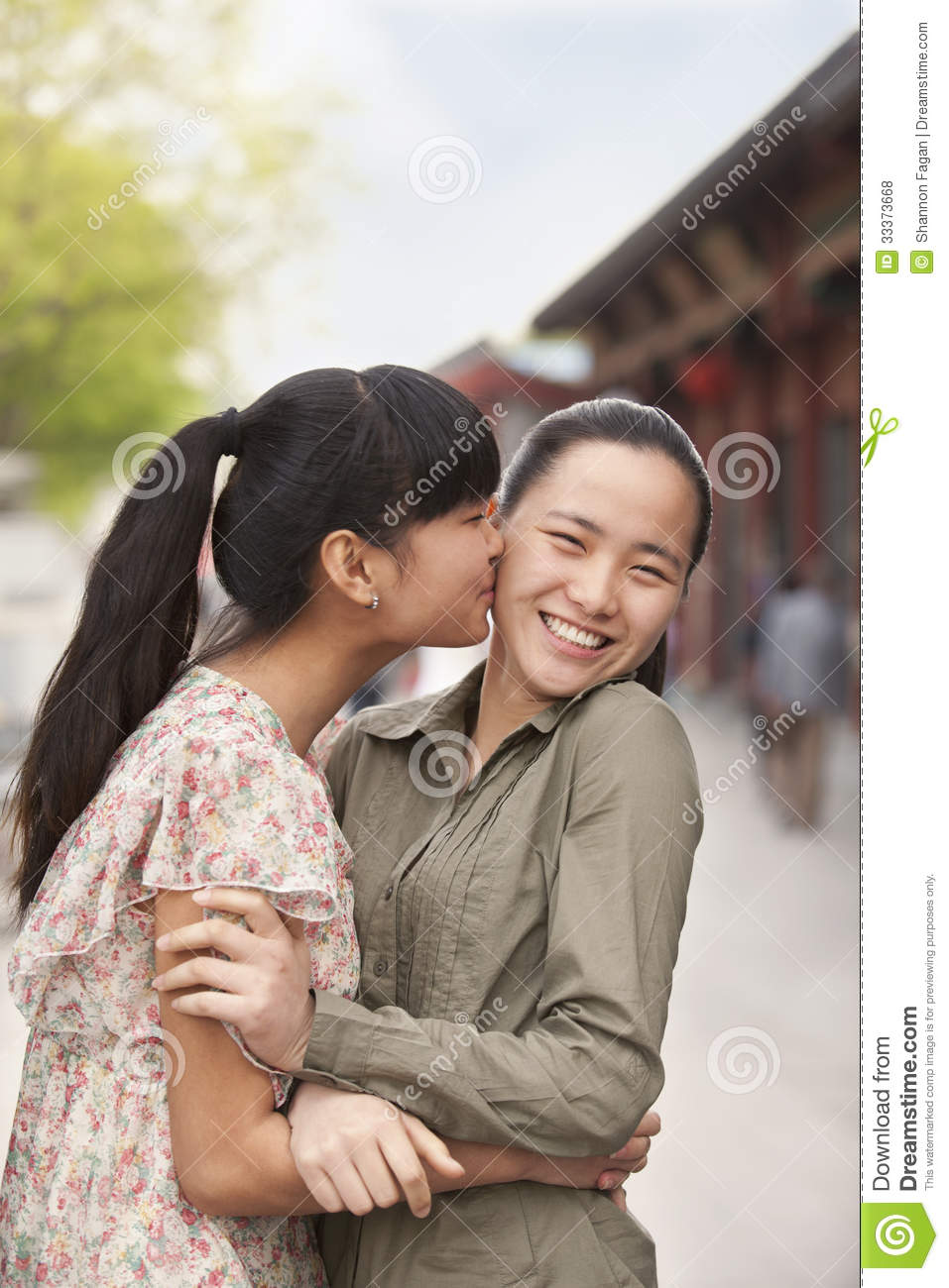 Two Young Women Embracing Royalty Free Stock Photos