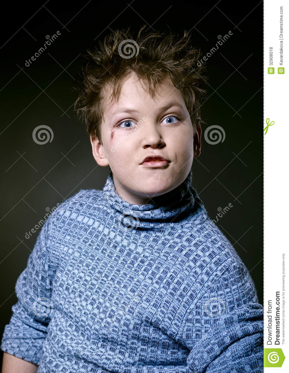 Unhappy boy grimaces stock photo. Image of defense. twisted - 32908018
