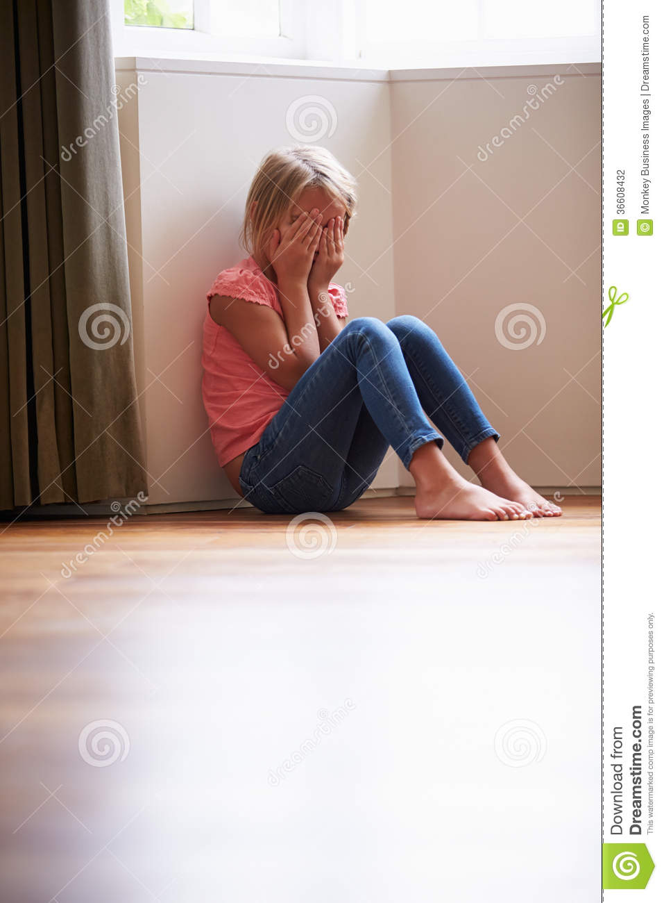 sad child sitting in corner royalty free stock photography
