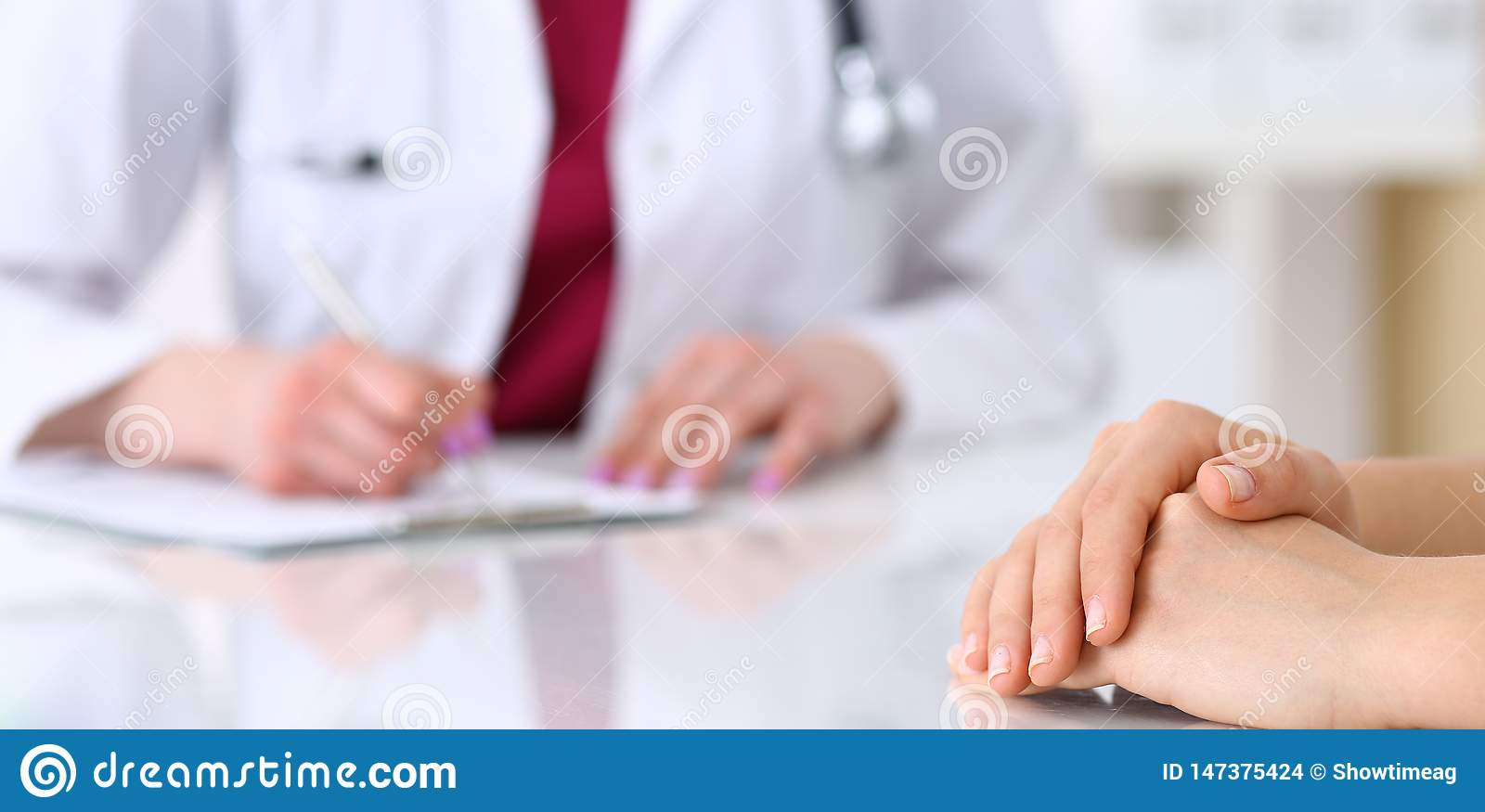 Unknown Doctor Woman Consulting Patient While Filling Up
