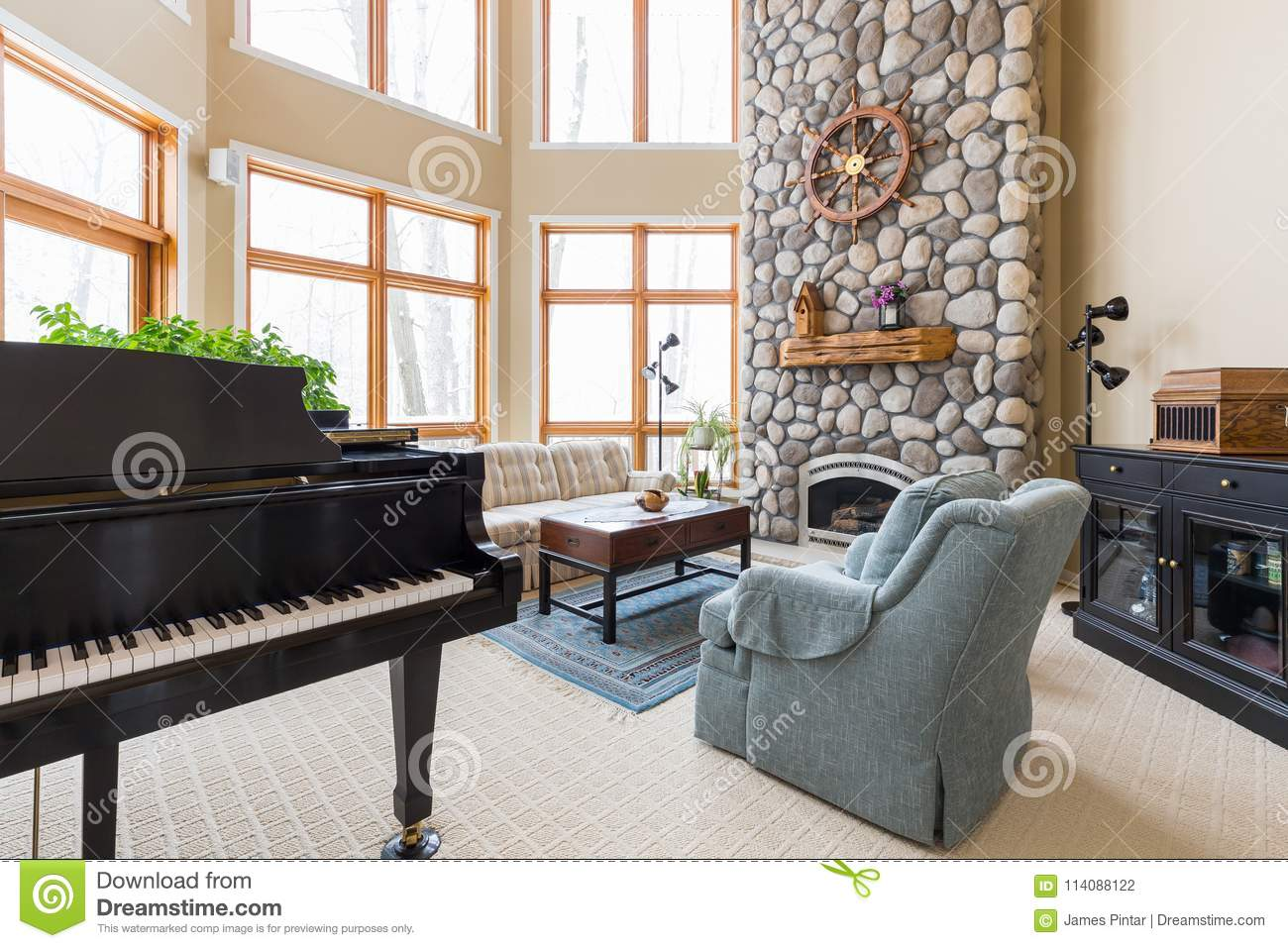 contemporary living rooms with fireplaces modern room decoration ideas stock photo image of stone 114088122 upscale inviting scene piano floor to ceiling fireplace and decor