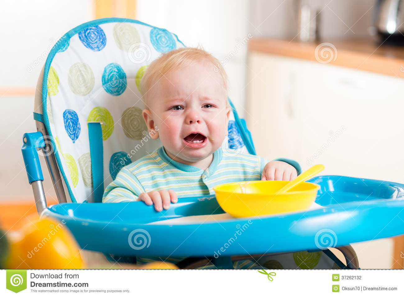 High Chair For Baby Boy Upset Baby Sitting In Highchair For Feeding Stock