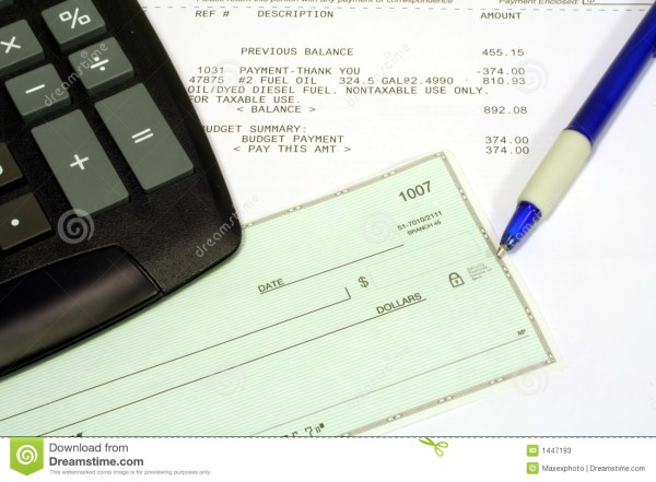 Utility Bill Personal Check And Calculator Stock - 1447193