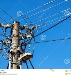 utility pole or power pole column with electric disconnect power blue clear sky three phase power line connection [ 1300 x 956 Pixel ]