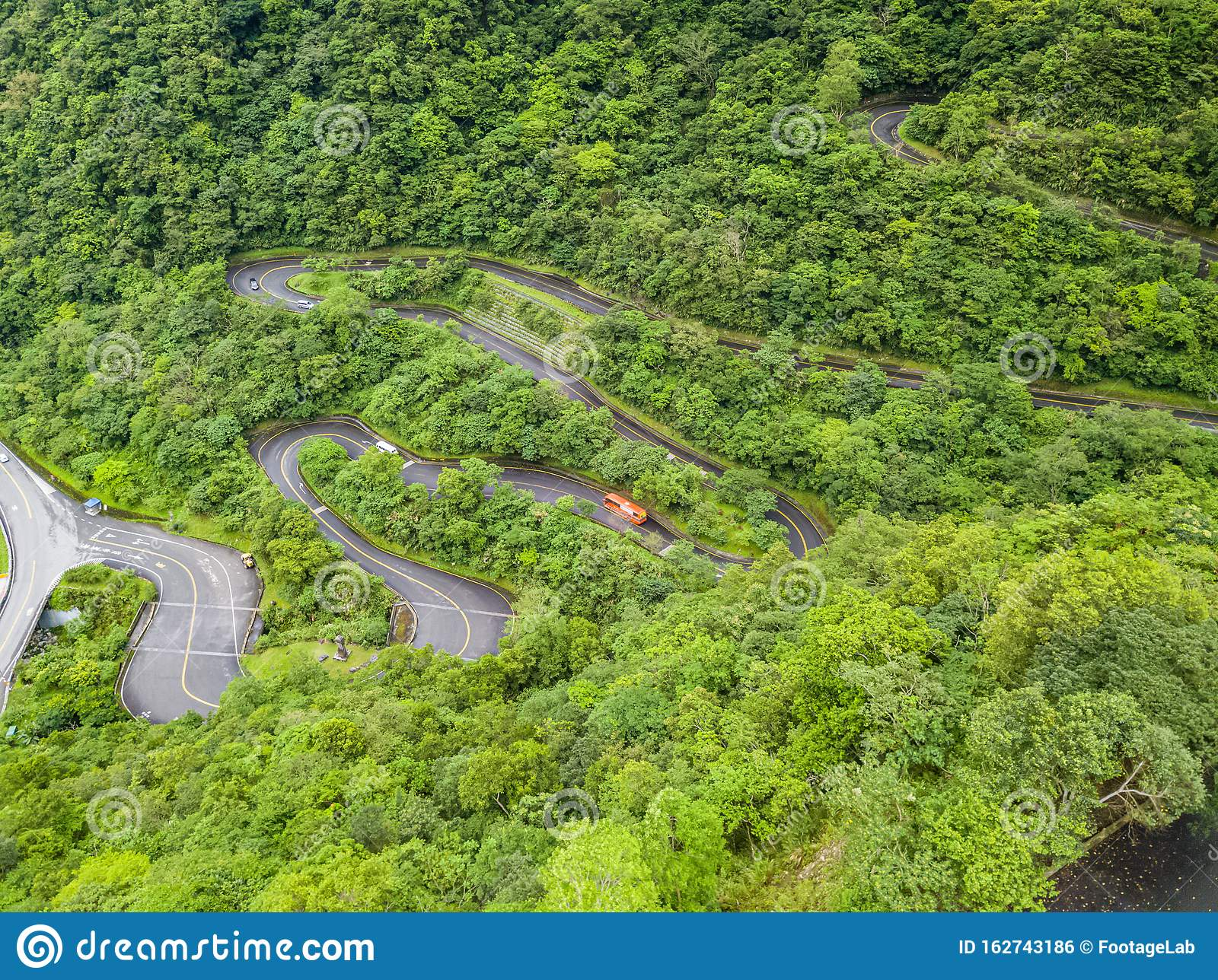 Vehicles Moving Along Curved Serpentinous Road Among Green Lush Forest Trees In Taroko Gorge National Park In Taiwan Stock Photo - Image of ...