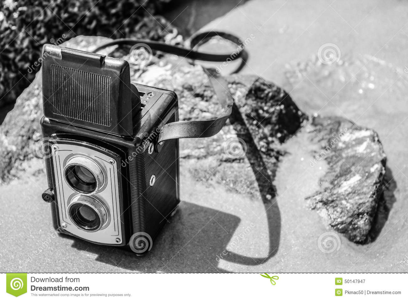 vintage camera on beach in black and white stock image image of sand yesteryear 50147947