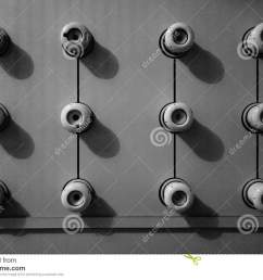 a black and white image of an old fuse box consisting of twelve circular ceramic fuses [ 1300 x 963 Pixel ]